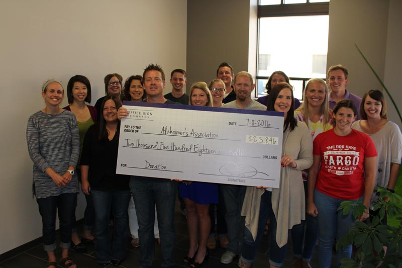Office Sign Company Donates to Alzheimer's Association